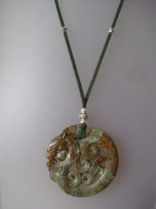 Green jade pendant carved on both sides