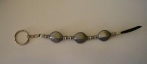 Clauer de resina i antelina negra, 185x25 mm