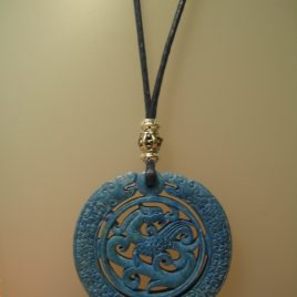Blue Jade Pendant, 65 mm diameter, waxed cotton cord blue and silver metal trimmings