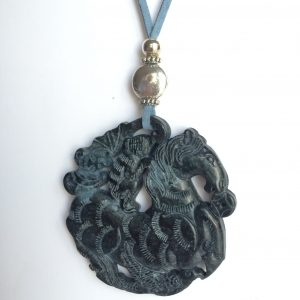 330-315 Jade pendant, cut on both sides, 65mm diametre, Blue suede and silver trimmings
