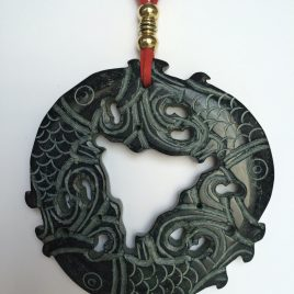 336-315 Black jade pendant, cut on both sides, 100mm diameter, red suede and gold trimmings
