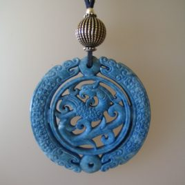 223-1114 Blue jade pendant, 70mm diameter, antelina blava, platejades.jpg trimmings