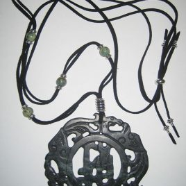 Black jade pendant carved two caresk
