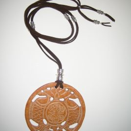 357-Brown jade pendant, advertise dues cares, 100 mm diameter, brown suede and silver trimmings